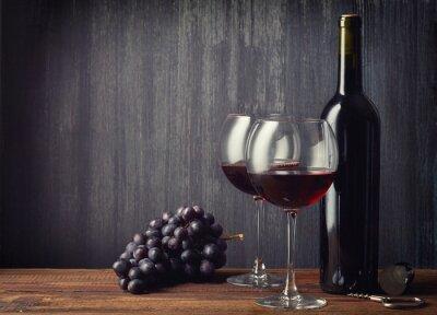 Fototapeta Láhev a dvě sklenice červeného vína