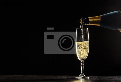 Fototapeta láhev šampaňského a brýle tmavém pozadí