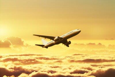 Fototapeta Letadlo na obloze při západu slunce