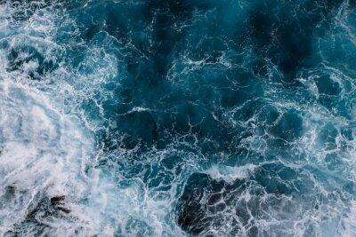 Fototapeta Letecký pohled na vlny oceánu. Modré pozadí vody