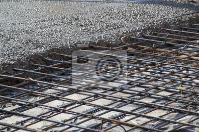 Fototapeta lití betonu do připraveného místa s kovovým rámem