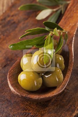 Fototapeta Lžíce se zelenými olivami