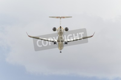 Fototapeta MADRID, SPAIN - FEBRUARY 14th 2015: Aircraft -Bombardier CRJ-900-, of -Iberia- airline, is landing on Madrid-Barajas -Adolfo Suarez- airport, on February 14th 2015.