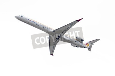 Fototapeta MADRID, SPAIN - MAY 3th 2015: Aircraft -Bombardier Canadair CRJ-1000-, of -Air Nostrum- airline, is taking off from Madrid-Barajas -Adolfo Suarez- airport, on May 3th 2015.