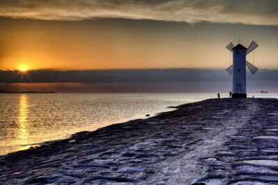 Fototapeta Maják větrný mlýn Stawa Mlyny, Swinoujscie, Baltic Sea, Polsko