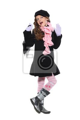 Fototapeta Malá krásná dívka je na podzim oblečení na bílé