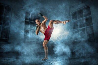 Fototapeta Mladý muž kickboxing