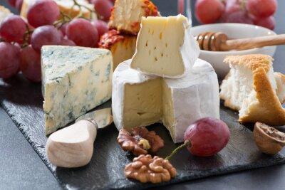 Fototapeta molded cheeses and snacks on the blackboard