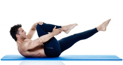 Fototapeta Muž fitness pilates exercices izolované