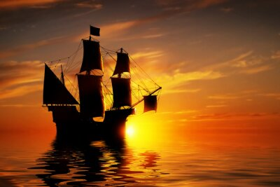 Fototapeta Old ancient pirate ship on peaceful ocean at sunset.