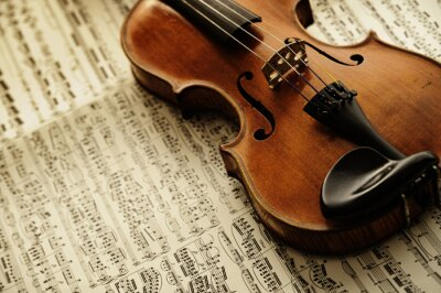 Fototapeta old and rare violin on a note sheet