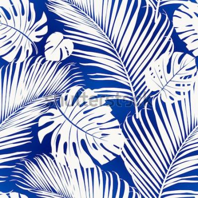 Fototapeta Opakující se vzor bezešvé s bílými siluety palmy listy na modrém pozadí.