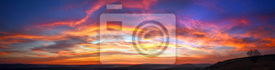 Fototapeta Panorama colorful magnificent sunset in countryside above hills and fields, beauty nature background
