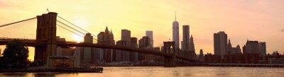 Fototapeta Panoramatu Manhattanu panorama s Brooklyn Bridge při západu slunce, New York, Spojené státy americké