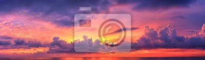 Fototapeta Phuket beach sunset, colorful cloudy twilight sky reflecting on the sand gazing at the Indian Ocean, Thailand, Asia.