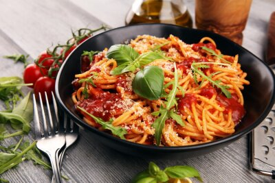 Fototapeta Plate of delicious spaghetti Bolognaise or Bolognese with savory minced beef and tomato sauce garnished with parmesan