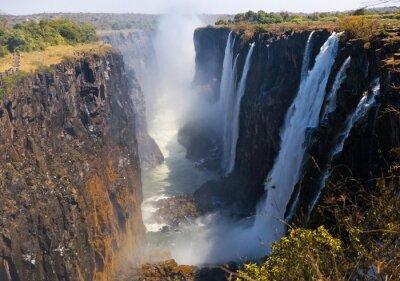 Fototapeta Pohled na Victoria Falls od země. Mosi-oa-Tunya Národní park. a světového dědictví UNESCO. Zambiya. Zimbabwe. Vynikající ukázkou.