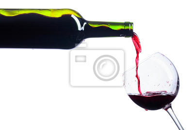 Fototapeta  Pouring red wine from bottle to glass isolated on white.