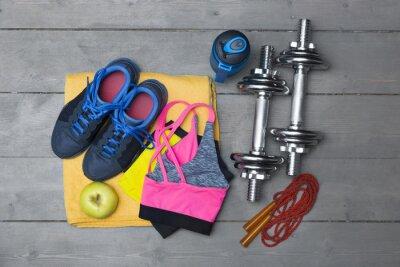 Fototapeta půdorysný pohled na barevné fitness vybavení na dřevěné podlaze