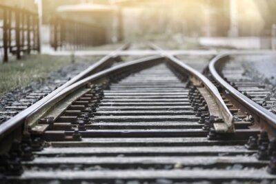 Fototapeta Railroad Track ve večerním slunci s dorazem
