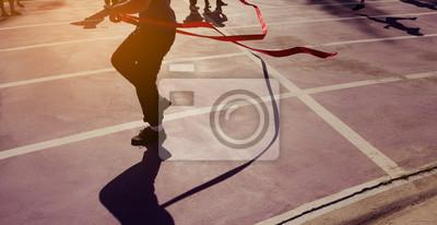 Fototapeta red ribbon at finish line .