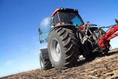 Fototapeta Red traktor s pluhem