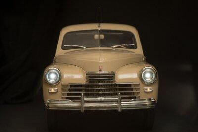 Fototapeta retro auto na černém pozadí