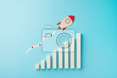 Fototapeta Rocket and chart on blue background business financial start up growth success concept object design