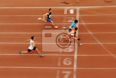 Fototapeta Rozmazané pohybové sprintové úpravy závodních závodníků