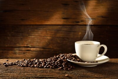 Fototapeta Šálek kávy a kávových zrn na staré dřevěné pozadí