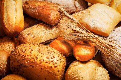 Fototapeta Sortiment upečeného chleba s pšenicí