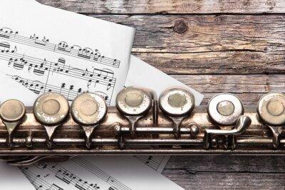 Fototapeta Starý flétna s hudebnin na rezavé dřevěnými deskami