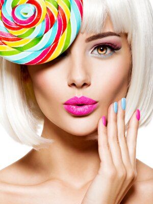 Fototapeta Surprised face of a pretty woman  with multicolor nails and pink lips