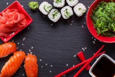 Fototapeta sushi a rohlíky na břidlicové tabulky