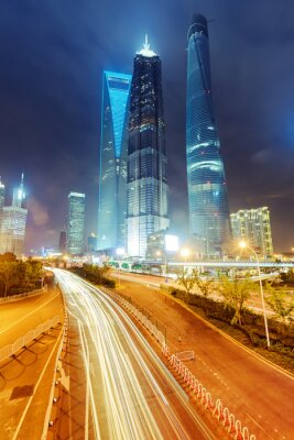 Fototapeta the light trails on the modern building background in shanghai c