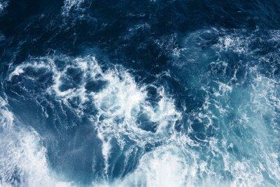 Fototapeta Top view on blue ocean waves.
