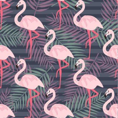 Fototapeta Tropický trendový bezešvý vzor s růžovým plameňákem, ananasem, tropickými listy. Pláž pozadí. Tropický ráj