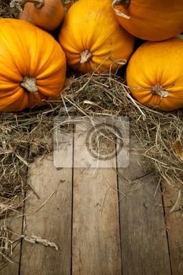 umění oranžové dýně na dřevěném pozadí