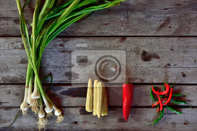 Fototapeta Vegetables composition on wooden background