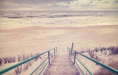Fototapeta Vintage tónovaný dřevěných schodech na pláži