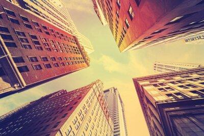 Fototapeta Vintage tónovaný mrakodrapy na Manhattanu při západu slunce, NYC.