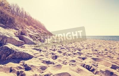 Fototapeta Vintage tónovaný obraz pláži při západu slunce.