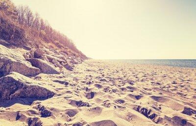 Fototapeta Vintage tónovaný pláži při západu slunce.