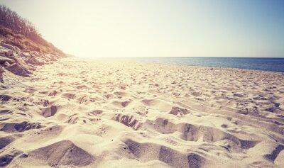 Fototapeta Vintage tónovaný pláži při západu slunce, Rewal v Polsku.