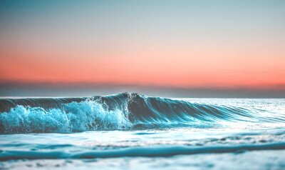 Fototapeta vlna při západu slunce