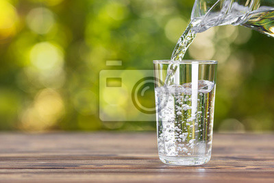 Fototapeta water pouring into glass