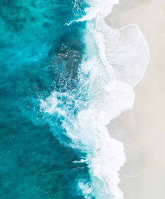 Fototapeta  wave of blue ocean on sandy beach. Background.