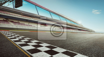 Fototapeta Wide angle view empty asphalt international race track with start and finish line , motion blur effect apply .
