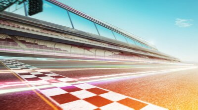 Fototapeta Wide angle view empty asphalt international race track with start and finish line , speed lighting and motion blur effect apply .