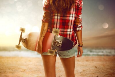 Fototapeta Woman with longboard at the beach